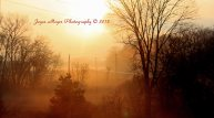 Foggy sunset by Spillville