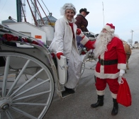 Jim Dotzenrod and his team of horsed brought Santa and Mrs. Claus to town.
