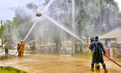 Fireman water ball competition brought in many area firefighters for the event Sunday.