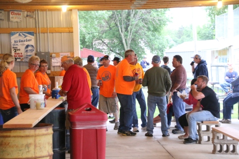 Groups enjoys brats and drinks at the park after the 5k