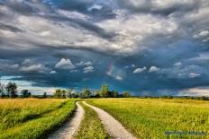 First rainbow farm driveway on Ossian blacktop at road.-1