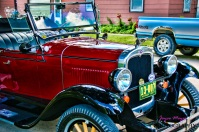 1927 Chevrolet parked on Spillville street by the clocks